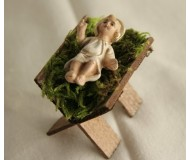 Krippenfigur-Jesus-Kind-in-der-Holz-Krippe
